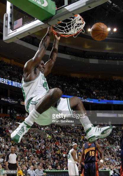 Kendrick Perkins of the Boston Celtics dunks the ball during the game against the Golden State Warriors on November 18 2009 at the TD Garden in...