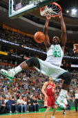 Kendrick Perkins of the Boston Celtics dunks the ball during the game against the Cleveland Cavaliers on April 4 2010 at the TD Garden in Boston...