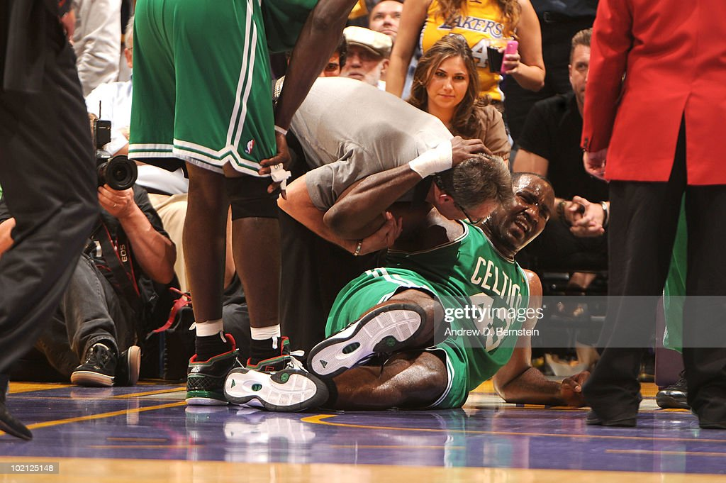 <a gi-track='captionPersonalityLinkClicked' href=/galleries/search?phrase=Kendrick+Perkins&family=editorial&specificpeople=211461 ng-click='$event.stopPropagation()'>Kendrick Perkins</a> #43 of the Boston Celtics goes down with an injury in the first quarter against the Los Angeles Lakers in Game Six of the 2010 NBA Finals on June 15, 2010 at Staples Center in Los Angeles, California.