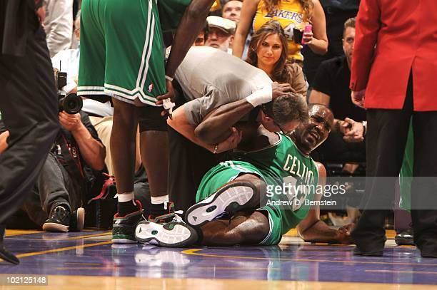 Kendrick Perkins of the Boston Celtics goes down with an injury in the first quarter against the Los Angeles Lakers in Game Six of the 2010 NBA...