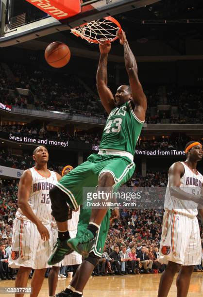 Kendrick Perkins of the Boston Celtics puts down a dunk against the Charlotte Bobcats on February 7 2011 at Time Warner Cable Arena in Charlotte...