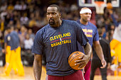 Kendrick Perkins of the Cleveland Cavaliers warms up on the court prior to the game against the Indiana Pacers at Quicken Loans Arena on March 20...