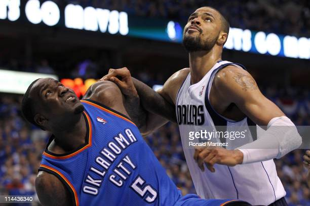 Kendrick Perkins of the Oklahoma City Thunder and Tyson Chandler of the Dallas Mavericks battle for position in the second quarter in Game Two of the...