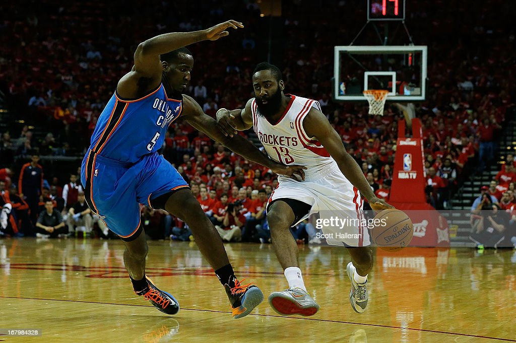 <a gi-track='captionPersonalityLinkClicked' href=/galleries/search?phrase=Kendrick+Perkins&family=editorial&specificpeople=211461 ng-click='$event.stopPropagation()'>Kendrick Perkins</a> #5 of the Oklahoma City Thunder defends against <a gi-track='captionPersonalityLinkClicked' href=/galleries/search?phrase=James+Harden&family=editorial&specificpeople=4215938 ng-click='$event.stopPropagation()'>James Harden</a> #13 of the Houston Rockets in Game Six of the Western Conference Quarterfinals of the 2013 NBA Playoffs at the Toyota Center on May 3, 2013 in Houston, Texas.