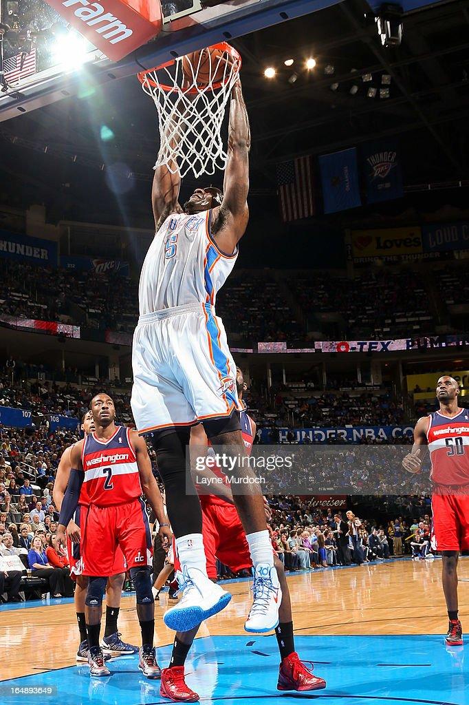 Kendrick Perkins #5 of the Oklahoma City Thunder dunks against the Washington Wizards on March 27, 2013 at the Chesapeake Energy Arena in Oklahoma City, Oklahoma.