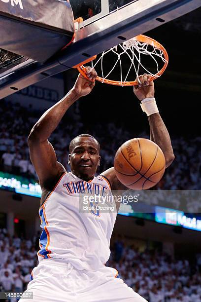 Kendrick Perkins of the Oklahoma City Thunder dunks the ball against the San Antonio Spurs in Game Six of the Western Conference Finals of the 2012...