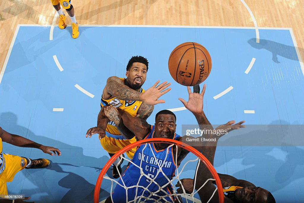 <a gi-track='captionPersonalityLinkClicked' href=/galleries/search?phrase=Kendrick+Perkins&family=editorial&specificpeople=211461 ng-click='$event.stopPropagation()'>Kendrick Perkins</a> #5 of the Oklahoma City Thunder goes up for a rebound against <a gi-track='captionPersonalityLinkClicked' href=/galleries/search?phrase=Wilson+Chandler&family=editorial&specificpeople=809324 ng-click='$event.stopPropagation()'>Wilson Chandler</a> #21 of the Denver Nuggets on December 17, 2013 at the Pepsi Center in Denver, Colorado.
