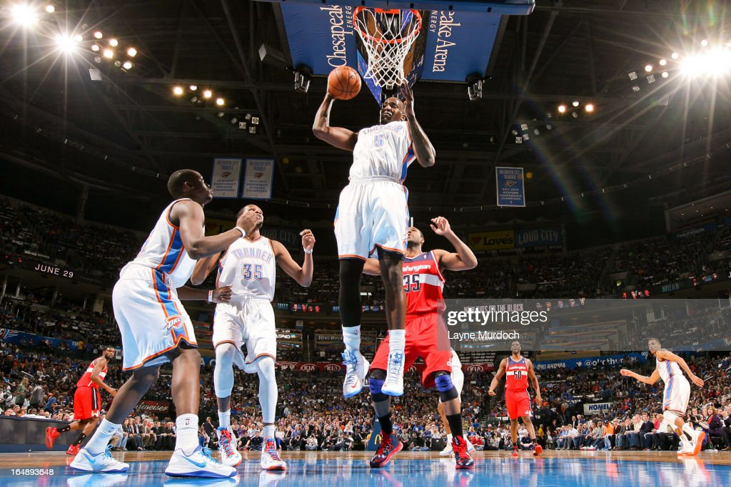 Kendrick Perkins #5 of the Oklahoma City Thunder grabs a rebound against the Washington Wizards on March 27, 2013 at the Chesapeake Energy Arena in Oklahoma City, Oklahoma.