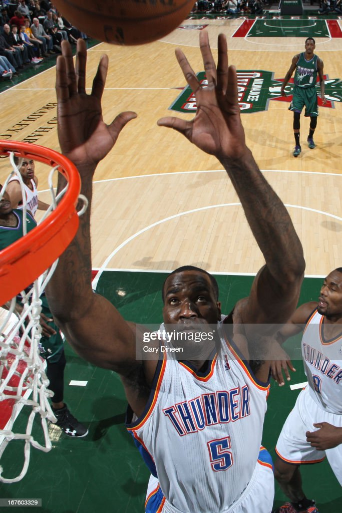 Kendrick Perkins #5 of the Oklahoma City Thunder grabs a rebound against the Milwaukee Bucks on March 30, 2013 at the BMO Harris Bradley Center in Milwaukee, Wisconsin.