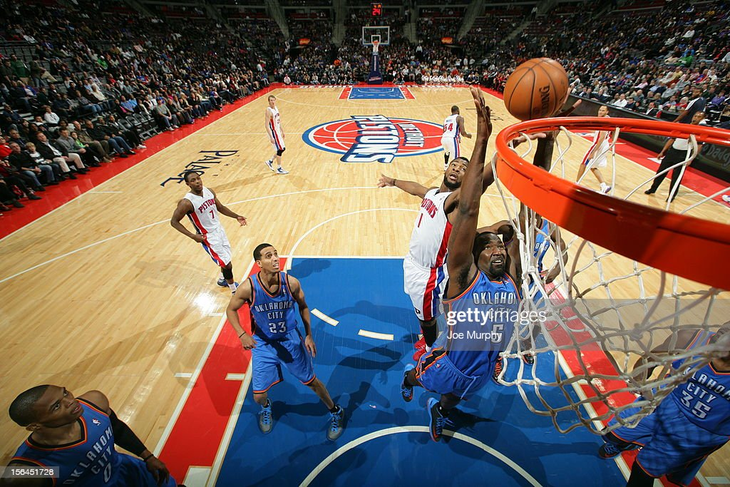 <a gi-track='captionPersonalityLinkClicked' href=/galleries/search?phrase=Kendrick+Perkins&family=editorial&specificpeople=211461 ng-click='$event.stopPropagation()'>Kendrick Perkins</a> #5 of the Oklahoma City Thunder grabs the rebound over <a gi-track='captionPersonalityLinkClicked' href=/galleries/search?phrase=Andre+Drummond&family=editorial&specificpeople=7122456 ng-click='$event.stopPropagation()'>Andre Drummond</a> #1 of the Detroit Pistons on November 12, 2012 at The Palace of Auburn Hills in Auburn Hills, Michigan.