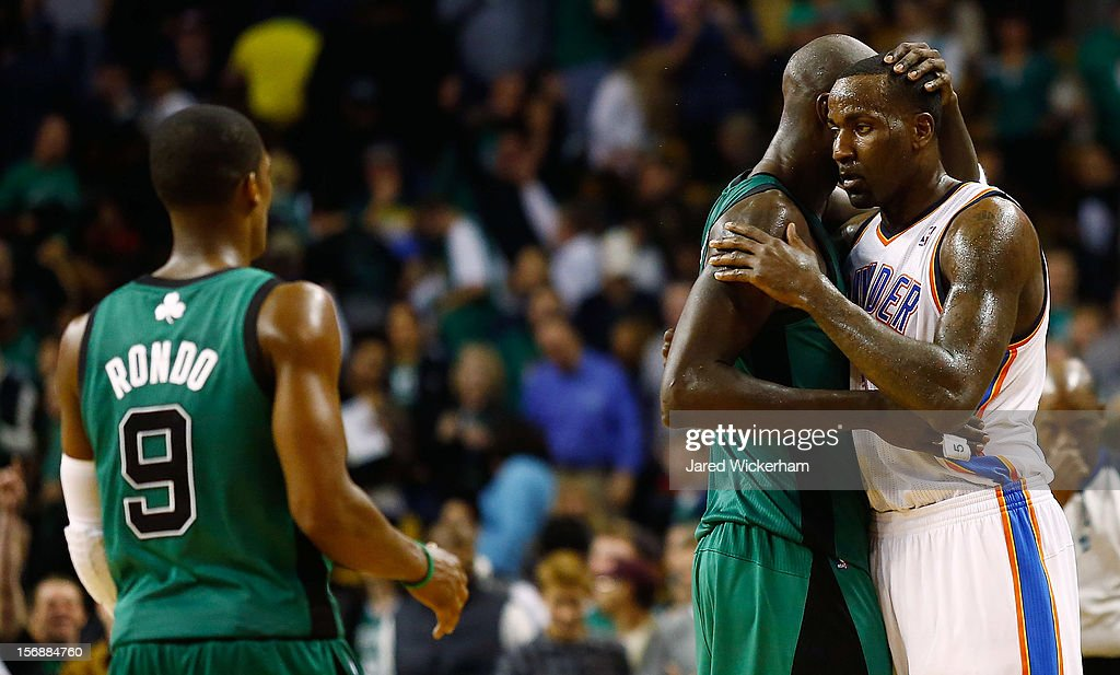 Kendrick Perkins #5 of the Oklahoma City Thunder hugs former teammate Kevin Garnett #5 of the Boston Celtics following the game on November 23, 2012 at TD Garden in Boston, Massachusetts.