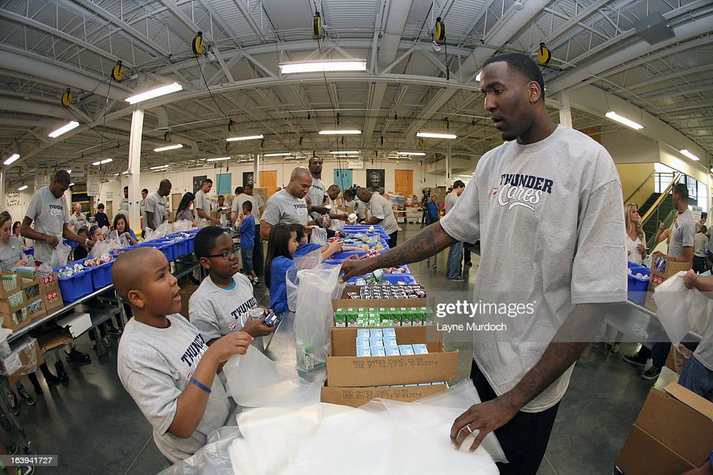 Kendrick Perkins #5 of the Oklahoma City Thunder joins Kids Cafe volunteers to assist with bagging and boxing food items for local families and schools on March 13, 2013 at the Regional Food Bank of Oklahoma in Oklahoma City, Oklahoma.