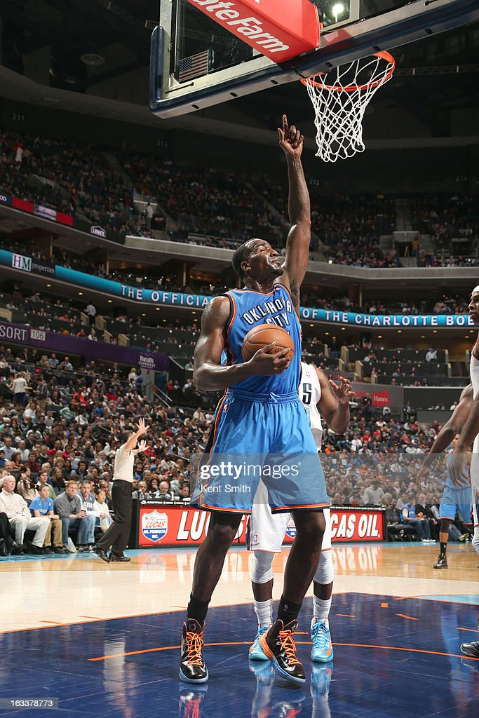 Kendrick Perkins #5 of the Oklahoma City Thunder points skyward during the game against the Charlotte Bobcats at the Time Warner Cable Arena on March 8, 2013 in Charlotte, North Carolina.