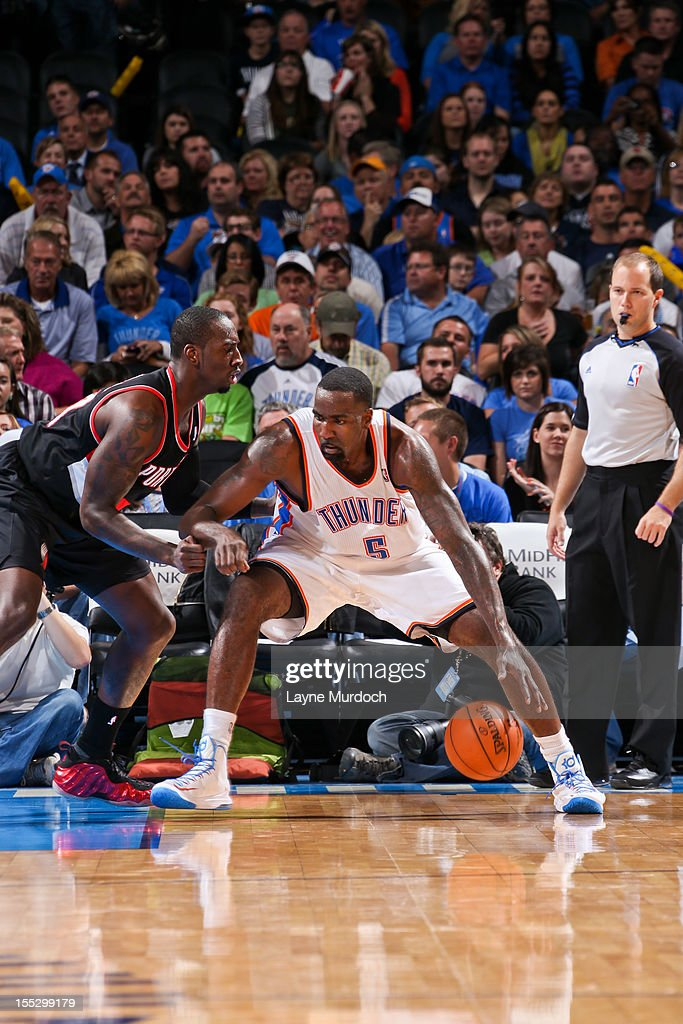 <a gi-track='captionPersonalityLinkClicked' href=/galleries/search?phrase=Kendrick+Perkins&family=editorial&specificpeople=211461 ng-click='$event.stopPropagation()'>Kendrick Perkins</a> #5 of the Oklahoma City Thunder posts-up against <a gi-track='captionPersonalityLinkClicked' href=/galleries/search?phrase=J.J.+Hickson&family=editorial&specificpeople=4226173 ng-click='$event.stopPropagation()'>J.J. Hickson</a> #21 of the Portland Trail Blazers on November 2, 2012 at the Chesapeake Energy Arena in Oklahoma City, Oklahoma.