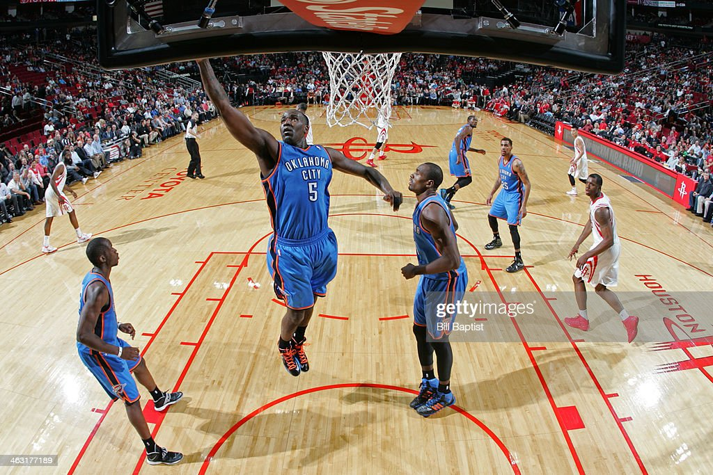 Kendrick Perkins #5 of the Oklahoma City Thunder rebounds against the Houston Rockets on January 16, 2014 at the Toyota Center in Houston, Texas.