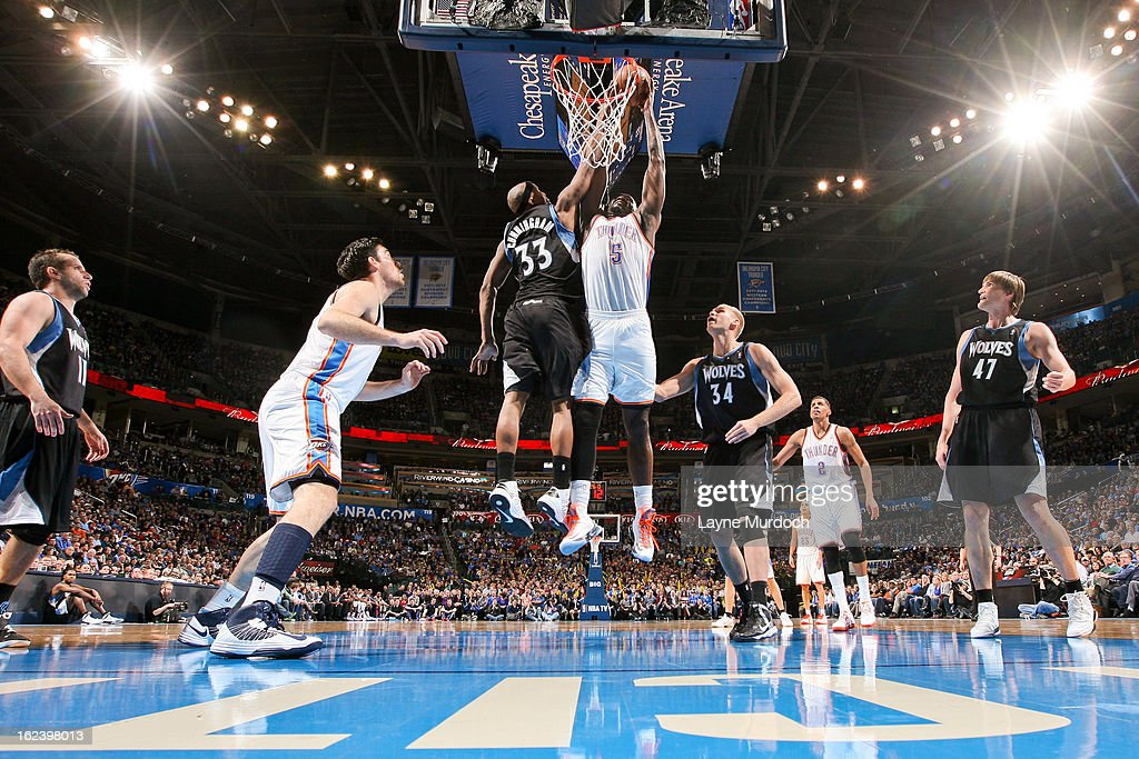 <a gi-track='captionPersonalityLinkClicked' href=/galleries/search?phrase=Kendrick+Perkins&family=editorial&specificpeople=211461 ng-click='$event.stopPropagation()'>Kendrick Perkins</a> #5 of the Oklahoma City Thunder rises for a dunk against <a gi-track='captionPersonalityLinkClicked' href=/galleries/search?phrase=Dante+Cunningham&family=editorial&specificpeople=683729 ng-click='$event.stopPropagation()'>Dante Cunningham</a> #33 of the Minnesota Timberwolves on February 22, 2013 at the Chesapeake Energy Arena in Oklahoma City, Oklahoma.