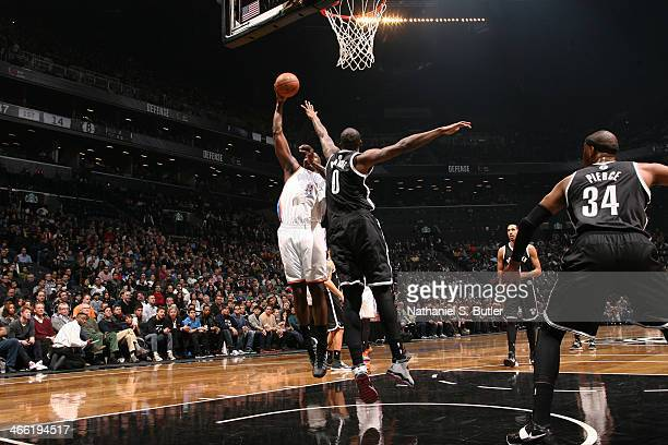Kendrick Perkins of the Oklahoma City Thunder shoots against Andray Blatche of the Brooklyn Nets at the Barclays Center on January 31 2014 in the...