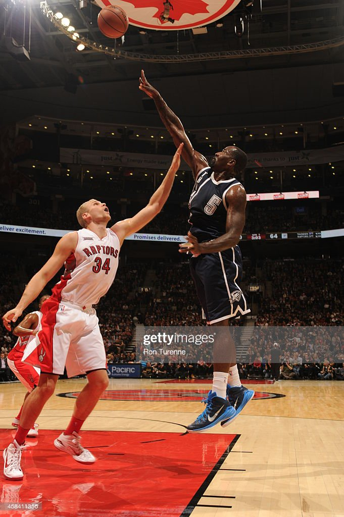 Kendrick Perkins of the Oklahoma City Thunder shoots against Greg Stiemsma of the Toronto Raptors on November 4 2014 at the Air Canada Centre in...
