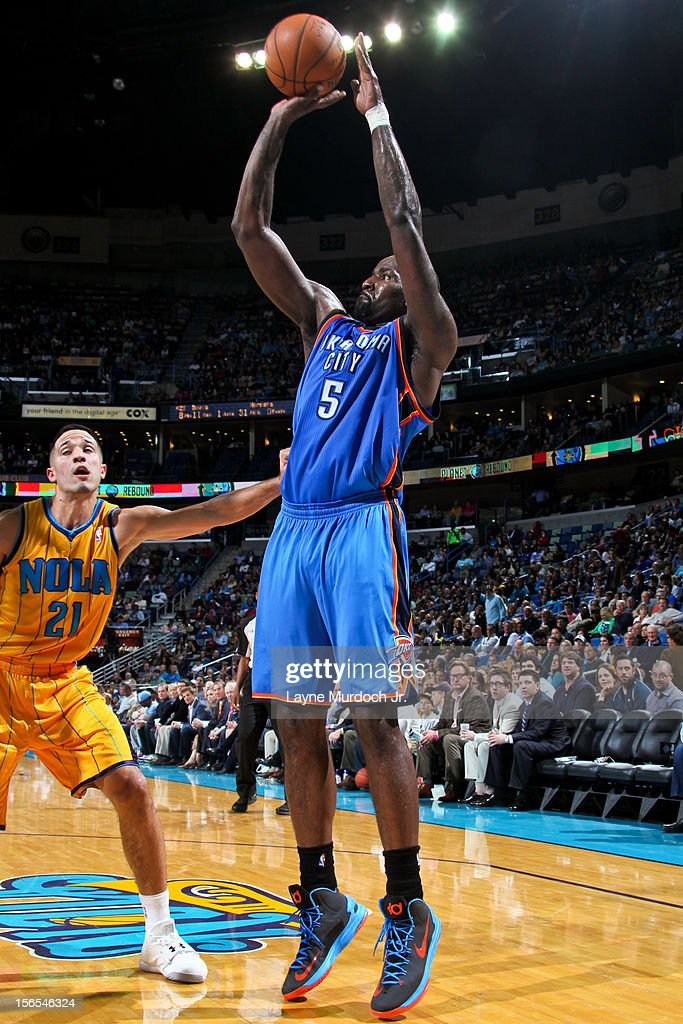 Kendrick Perkins #5 of the Oklahoma City Thunder shoots against Greivis Vasquez #21 of the New Orleans Hornets on November 16, 2012 at the New Orleans Arena in New Orleans, Louisiana.