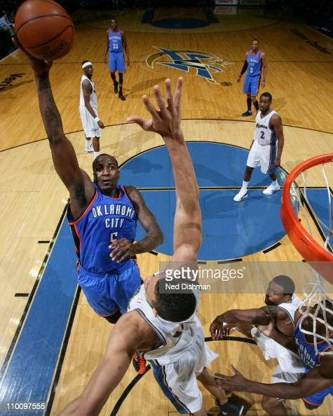 Kendrick Perkins of the Oklahoma City Thunder shoots against JaVale McGee of the Washington Wizards on March 14 2011 at the Verizon Center in...