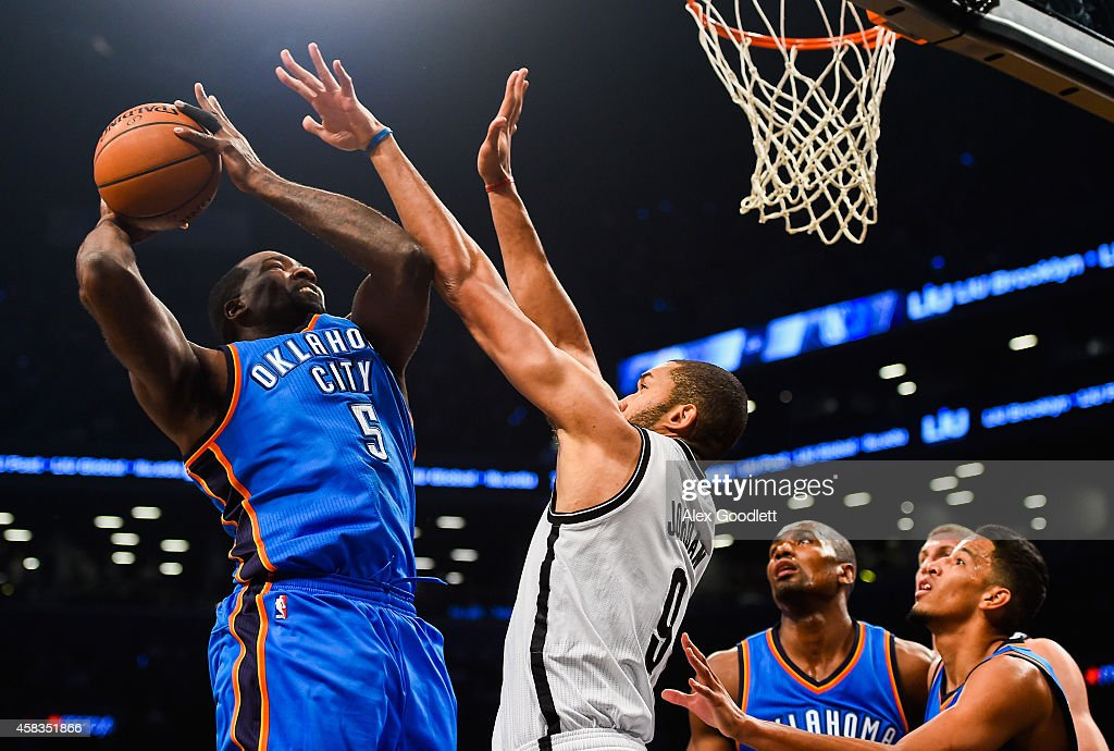 Kendrick Perkins #5 of the Oklahoma City Thunder shoots over Jerome Jordan #9 of the Brooklyn Nets in the first half at the Barclays Center on November 3, 2014 in the Brooklyn borough of New York City.