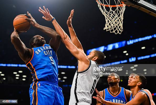 Kendrick Perkins of the Oklahoma City Thunder shoots over Jerome Jordan of the Brooklyn Nets in the first half at the Barclays Center on November 3...