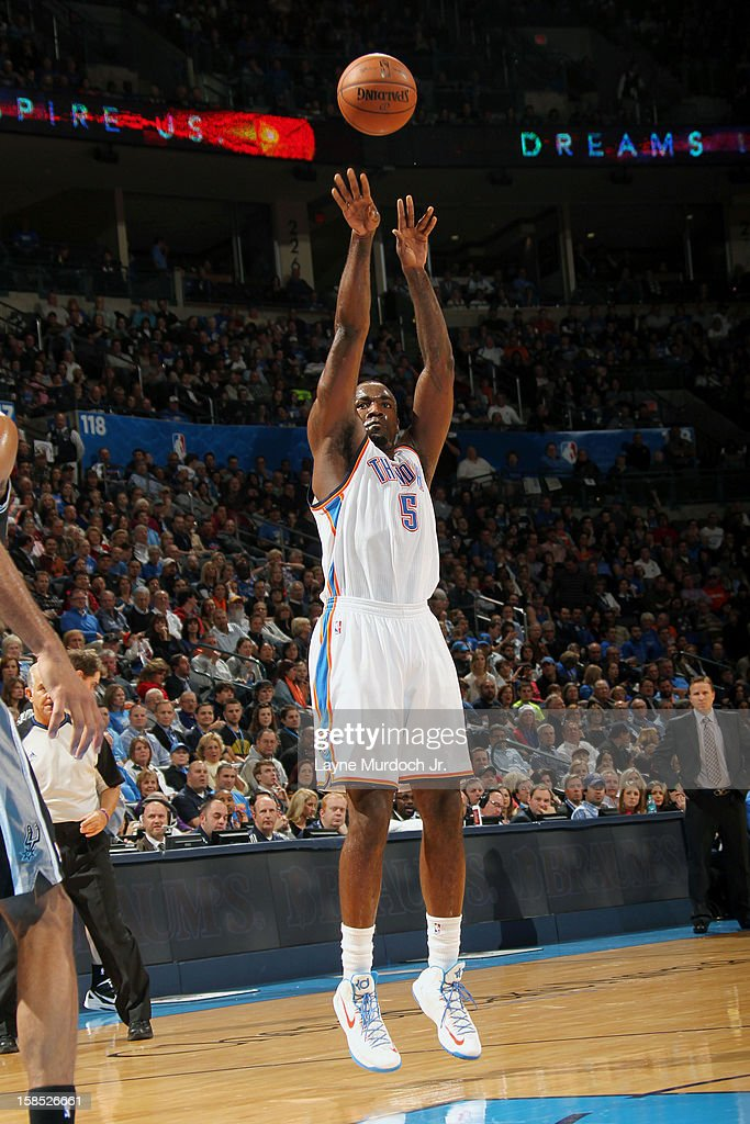 <a gi-track='captionPersonalityLinkClicked' href=/galleries/search?phrase=Kendrick+Perkins&family=editorial&specificpeople=211461 ng-click='$event.stopPropagation()'>Kendrick Perkins</a> #5 of the Oklahoma City Thunder takes a medium range shot against the San Antonio Spurs during an NBA game on December 17, 2012 at the Chesapeake Energy Arena in Oklahoma City, Oklahoma.