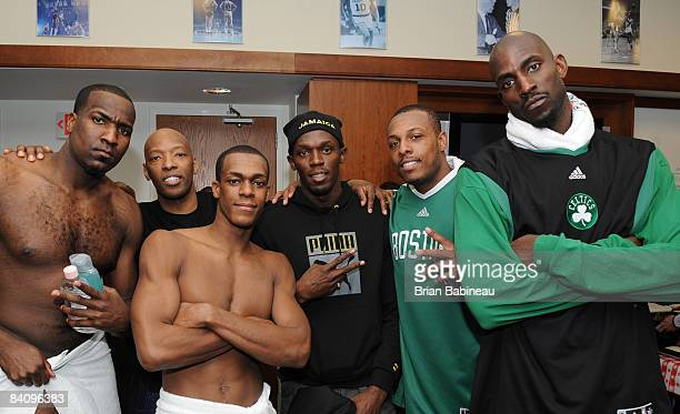 Kendrick Perkins Sam Cassell Rajon Rondo Paul Pierce and Kevin Garnett of the Boston Celtics pose with Usain Bolt after the game against the Chicago...