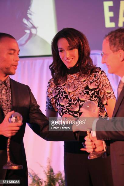 Kendrick Sampson presents the Global Impact Awards to Jennifer Beals and Michael Green at the EARTHxGlobal Gala on April 21 2017 in Dallas Texas
