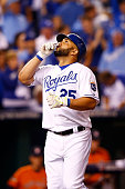 Kendrys Morales of the Kansas City Royals celebrates after hitting a solo home run in the second inning against the Houston Astros during game one of...