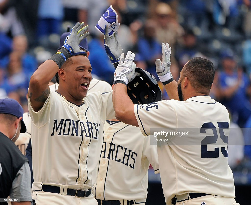 Kendrys Morales #25 of the Kansas City Royals celebrates his two-run walk-off home run with Salvador Perez #13 of the Kansas City Royals in the 13th inning against the Atlanta Braves at Kauffman Stadium on May 15, 2016 in Kansas City, Missouri. The Royals won 4-2.