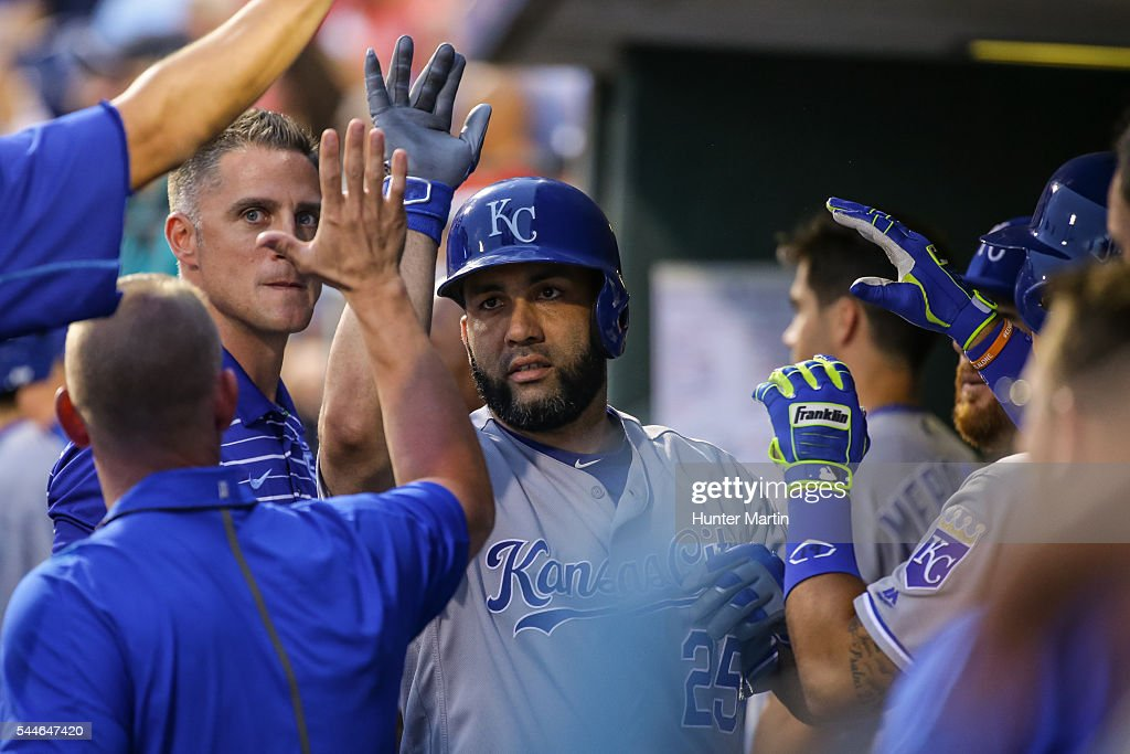 Kendrys Morales #25 of the Kansas City Royals celebrates with teammates after hitting a solo home run in the eighth inning during a game against the Philadelphia Phillies at Citizens Bank Park on July 2, 2016 in Philadelphia, Pennsylvania. The Royals won 6-2.