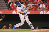 Kendrys Morales of the Kansas City Royals hits a single in the first inning against the Los Angeles Angels of Anaheim at Angel Stadium of Anaheim in...