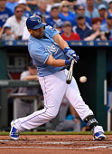 Kendrys Morales of the Kansas City Royals hits a single in the first inning against the Boston Red Sox at Kauffman Stadium on June 21 2015 in Kansas...