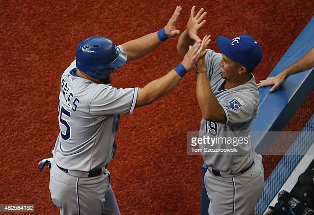Kendrys Morales of the Kansas City Royals is congratulated by Cheslor Cuthbert after scoring a run in the first inning during MLB game action against...