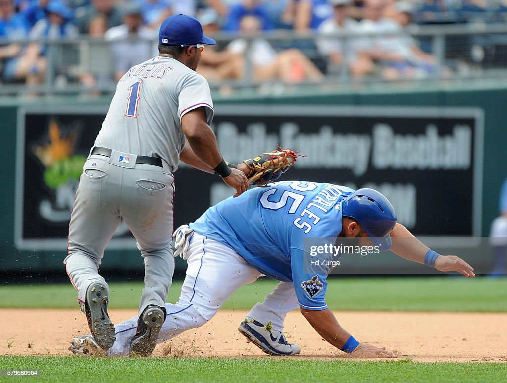 Kendrys Morales of the Kansas City Royals is tagged out by Elvis Andrus of the Texas Rangers as he tries to advance to third on a Alex Gordon single...