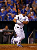 Kendrys Morales of the Kansas City Royals watches a long ball during the game against the Detroit Tigers at Kauffman Stadium on September 2 2015 in...