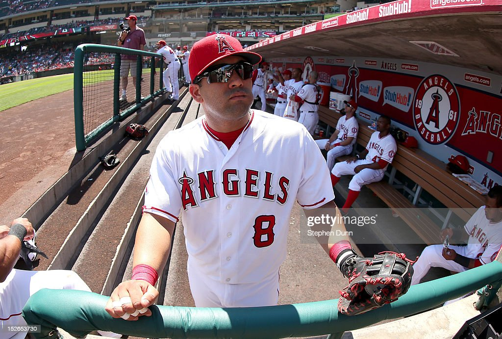 Kendrys Morales #8 of the Los Angeles Angels of Anaheim waits in the dugout just before the start of the game against the Chicago White Sox at Angel Stadium of Anaheim on September 23, 2012 in Anaheim, California. The Angels won 4-1.