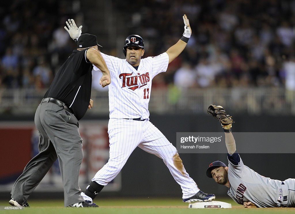 Kendrys Morales #17 of the Minnesota Twins reacts as umpire <a gi-track='captionPersonalityLinkClicked' href=/galleries/search?phrase=Brian+O%27Nora&family=editorial&specificpeople=545809 ng-click='$event.stopPropagation()'>Brian O'Nora</a> #7 calls him out at second base and <a gi-track='captionPersonalityLinkClicked' href=/galleries/search?phrase=Jason+Kipnis&family=editorial&specificpeople=5330784 ng-click='$event.stopPropagation()'>Jason Kipnis</a> #22 of the Cleveland Indians shows the ball during the seventh inning of the game on July 22, 2014 at Target Field in Minneapolis, Minnesota. The Indians defeated the Twins 8-2.