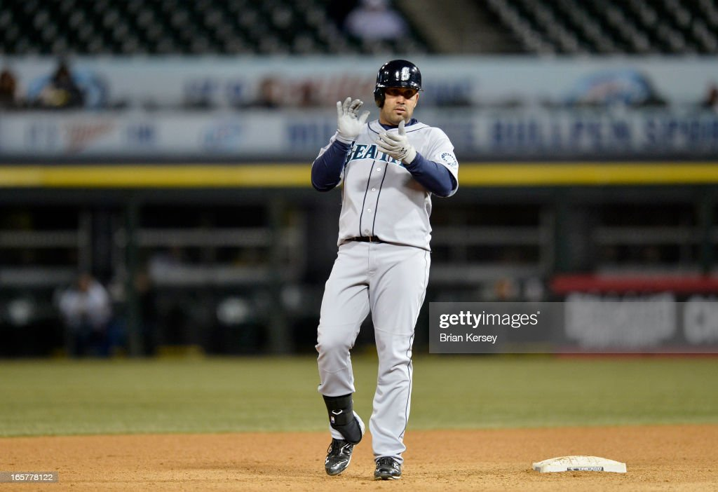 Kendrys Morales #8 of the Seattle Mariners claps after hitting an RBI double scoring teammate Franklin Gutierrez during the tenth inning against the Chicago White Sox on April 5, 2012 at U.S. Cellular Field in Chicago, Illinois. The Mariners won 8-7 in 10 innings.
