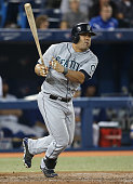Kendrys Morales of the Seattle Mariners hits a double in the ninth inning during MLB game action against the Toronto Blue Jays on September 23 2014...