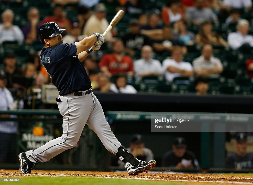 Kendrys Morales #8 of the Seattle Mariners hits a home run in the eighth inning against the Houston Astros at Minute Maid Park on April 23, 2013 in Houston, Texas.