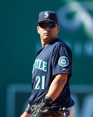 Kendrys Morales of the Seattle Mariners stands at first base during the fourth inning against the Boston Red Sox at Fenway Park on August 23 2014 in...