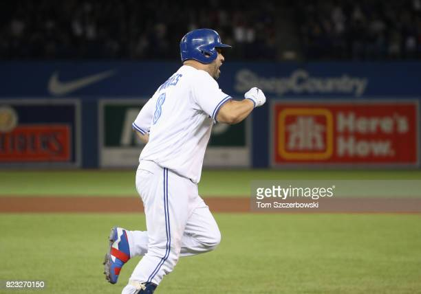 Kendrys Morales of the Toronto Blue Jays celebrates after hitting a gamewinning solo home run in the ninth inning during MLB game action against the...