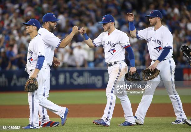 Kendrys Morales of the Toronto Blue Jays celebrates their victory with Josh Donaldson and Justin Smoak during MLB game action against the Tampa Bay...