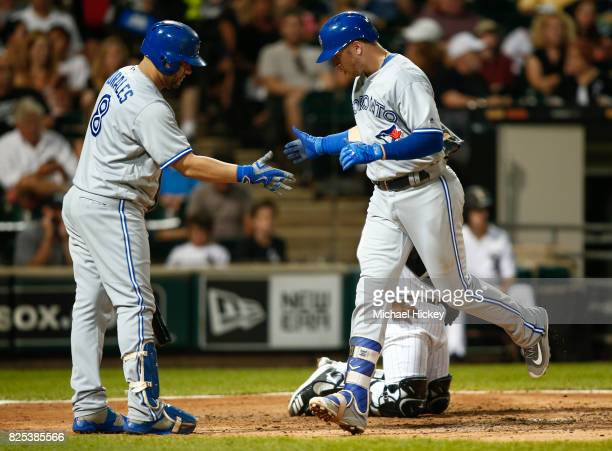Kendrys Morales of the Toronto Blue Jays congratulates Justin Smoak of the Toronto Blue Jays after a two run homer in the fifth inning against the...