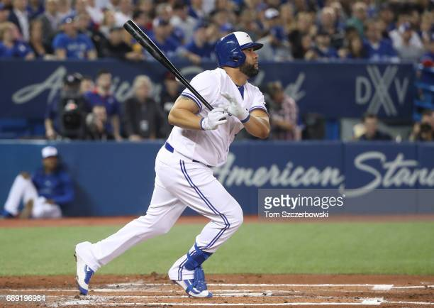 Kendrys Morales of the Toronto Blue Jays hits a single in the first inning during MLB game action against the Milwaukee Brewers at Rogers Centre on...