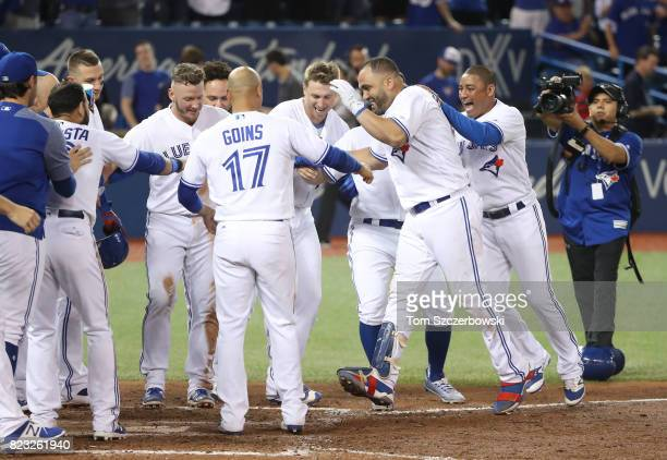 Kendrys Morales of the Toronto Blue Jays is congratulated by teammates after hitting a gamewinning solo home run in the ninth inning during MLB game...