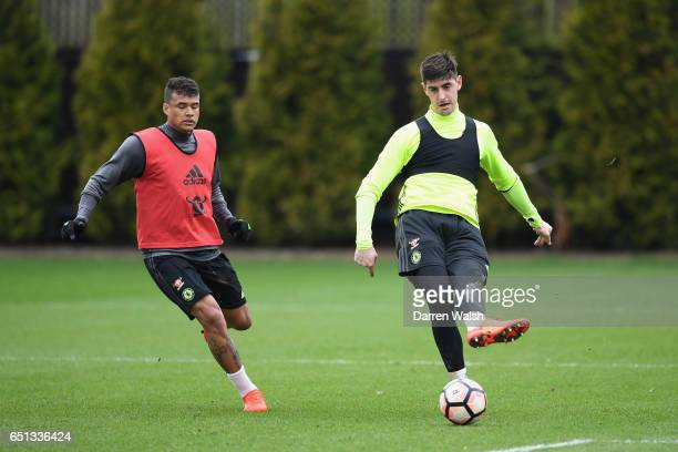 Kenedy and Thibaut Courtois of Chelsea during a training session at Chelsea Training Ground on March 10 2017 in Cobham England