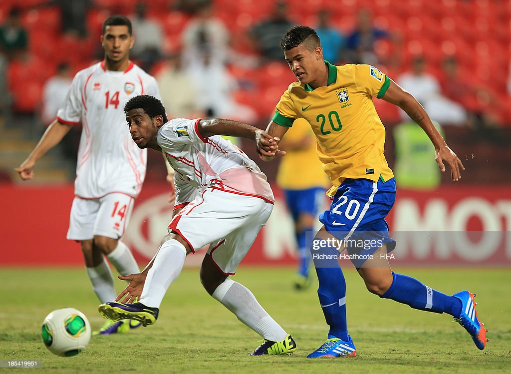 Kenedy of Brazil tries to go past Humaid Salmein of UAE during the FIFA U-17 World Cup UAE 2013 Group A match between United Arab Emirates and Brazil at the Mohamed Bin Zayed Stadium on October 20, 2013 in Abu Dhabi, United Arab Emirates.